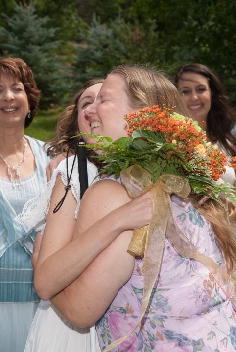 KJ and I hugging at my wedding